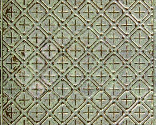 Gepatineerd koperen wandtegel met patroon voor een verouderde vintage look